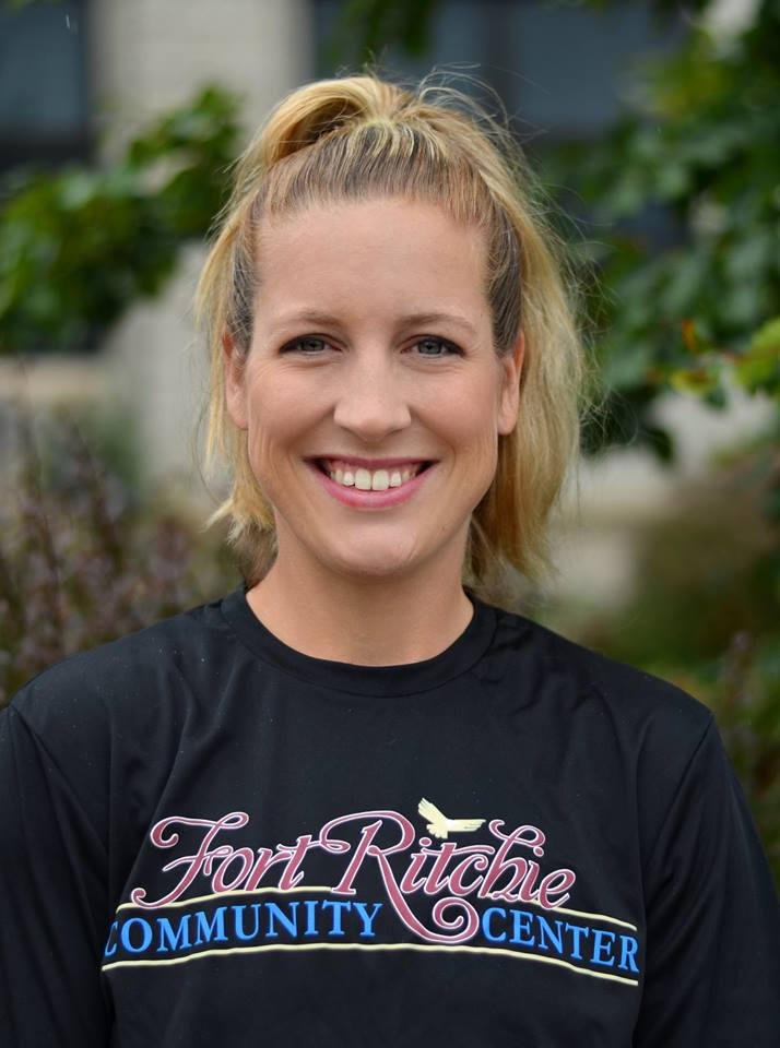 Amber Reaver, FRCC fitness instructor, wearing a black FRCC logo shirt outdoors