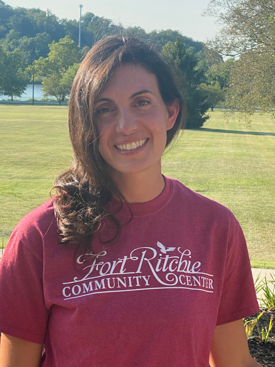 Joyce Johnson, FRCC Yoga Instructor, outdoors wearing a red FRCC logo t-shirt