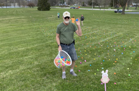 Santa in his classic car with children in the back
