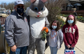 Washington County Commission President Jeff Cline with the Easter Bunny and two young children