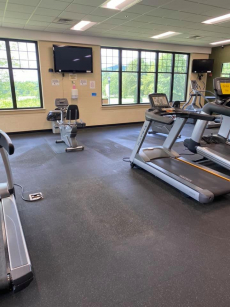 fitness center with treadmills distanced